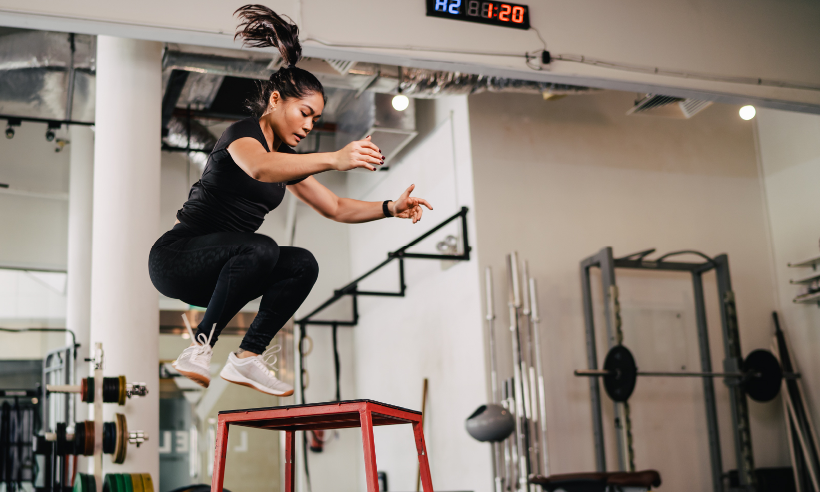 An image of a women jumping in Level